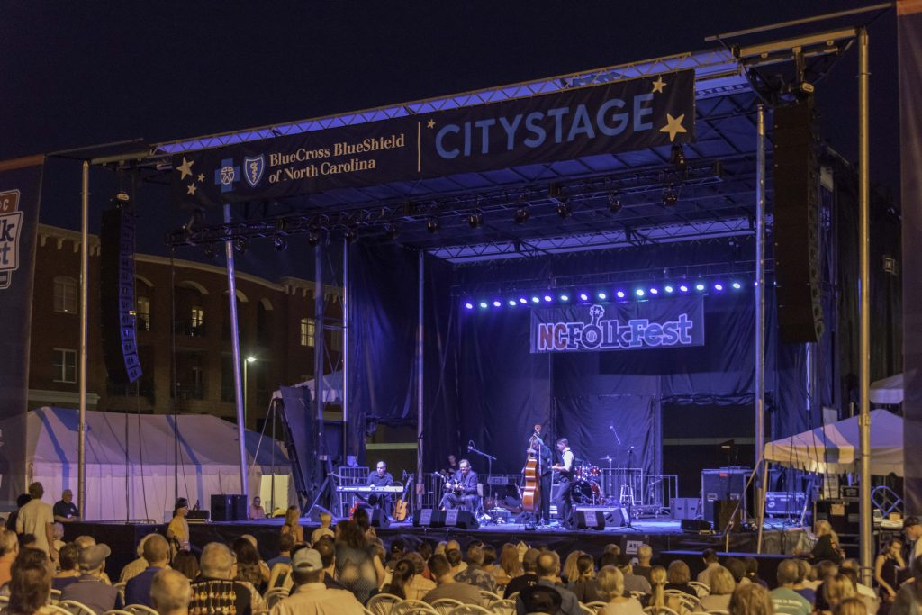 Musicians perform for a late night crowd at the North Carolina Folk Fest Blue Cross Blue Shield City Stage.