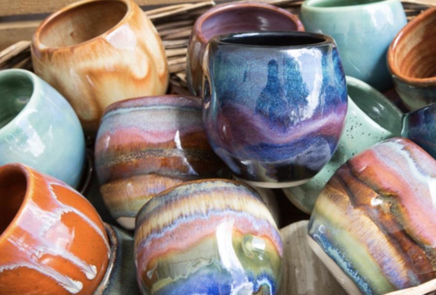 Multi-colored pottery mugs.