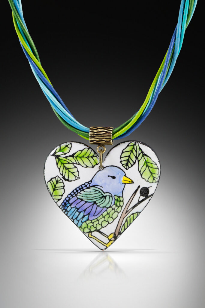 Heart shaped neckless with painted blue bird.