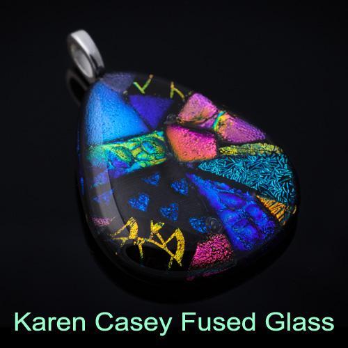 Multi-colored tear-shaped glass pendant.