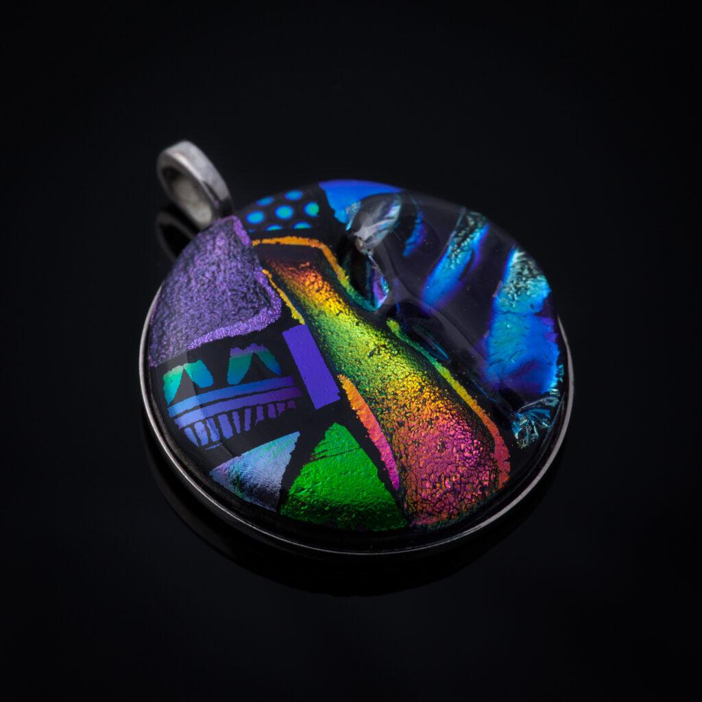 Multi-colored circular glass pendant.
